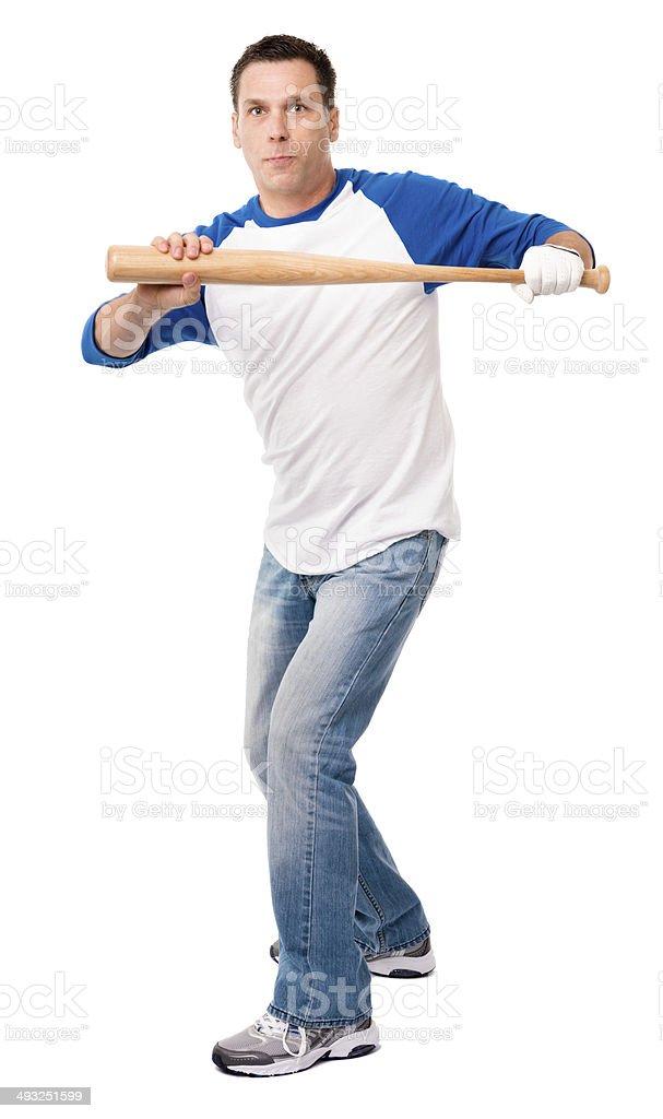 Man Swinging Baseball Bat Isolated on White Background royalty-free stock photo