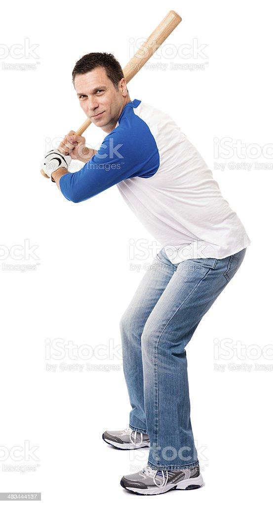 Man Swinging Baseball Bat Isolated on White Background stock photo