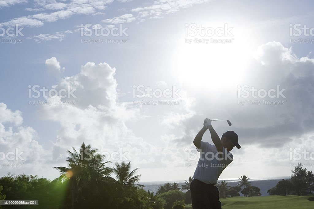 Man swinging golf club royalty-free stock photo