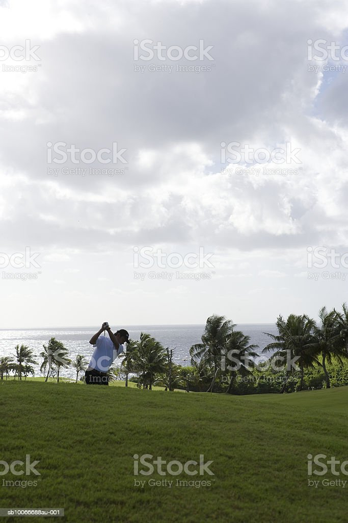 Man swinging golf club 免版稅 stock photo