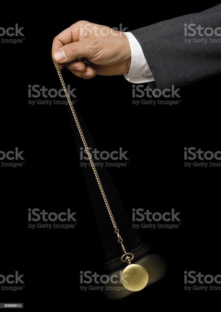 Man swinging hypnotizing device stock photo