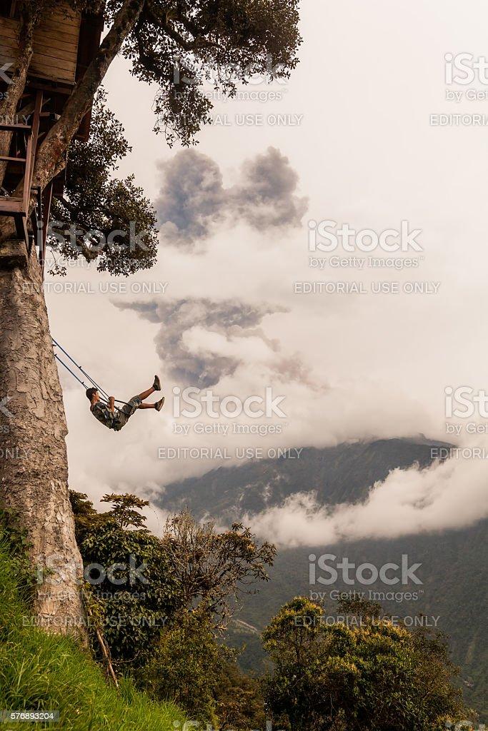 Man Swinging On A Swing In Banos De Agua Santa stock photo