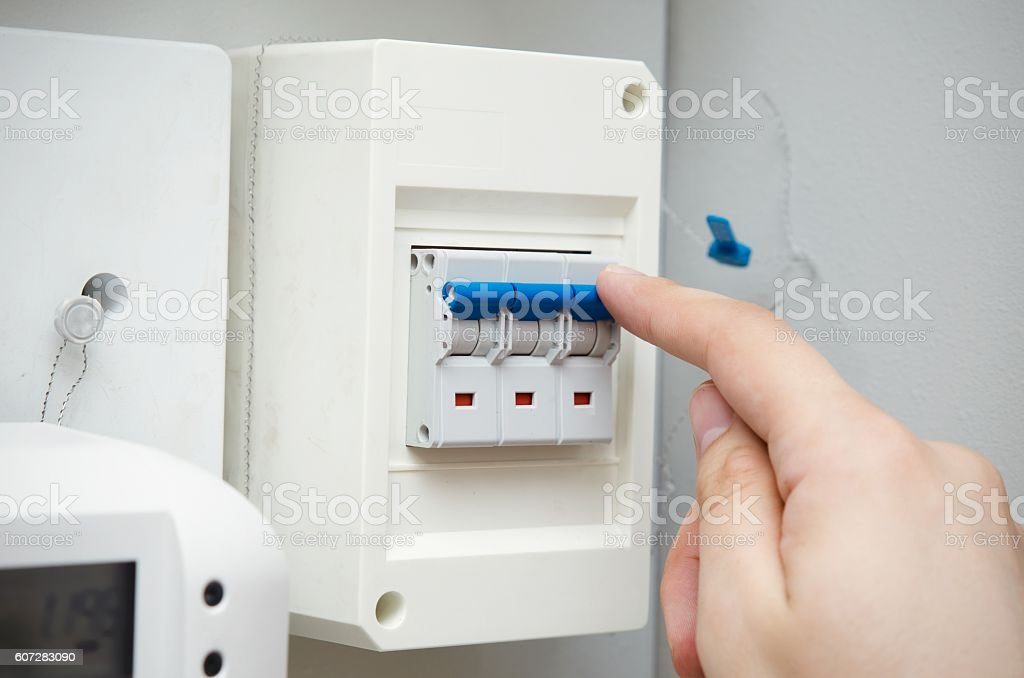 man switches automatic fuse electric equipment close up stock photo rh istockphoto com