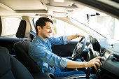 Man switching radio station while driving