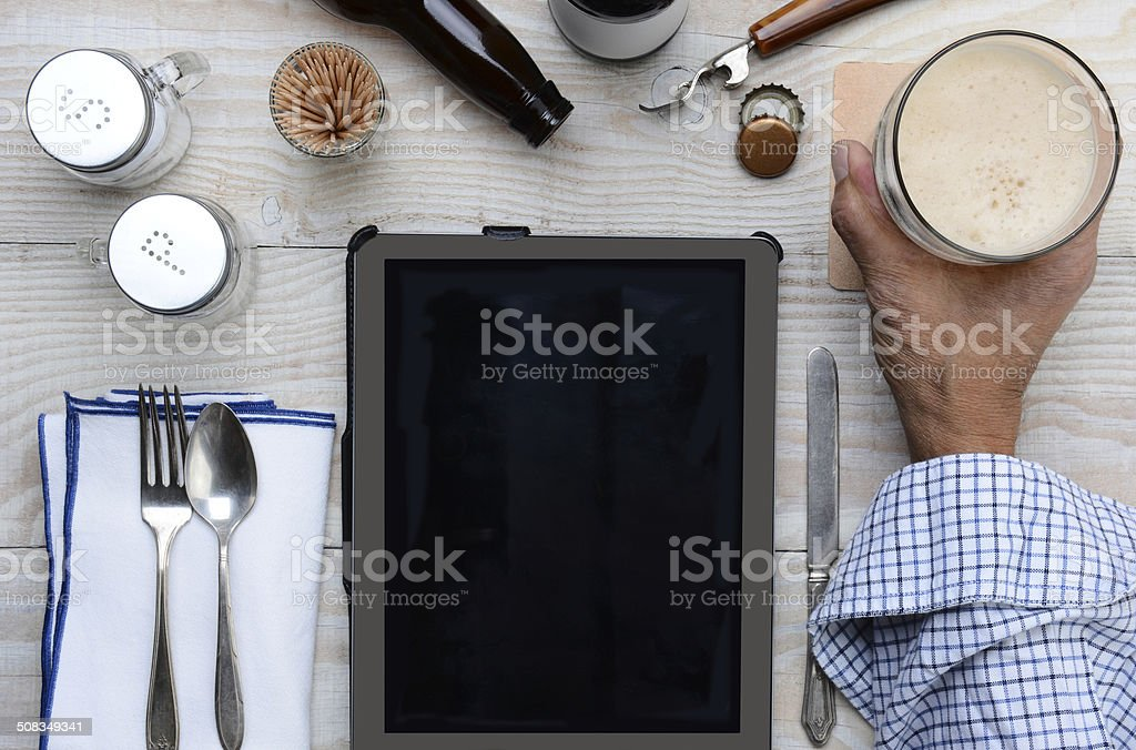 Man Tablet Computer and Beer stock photo