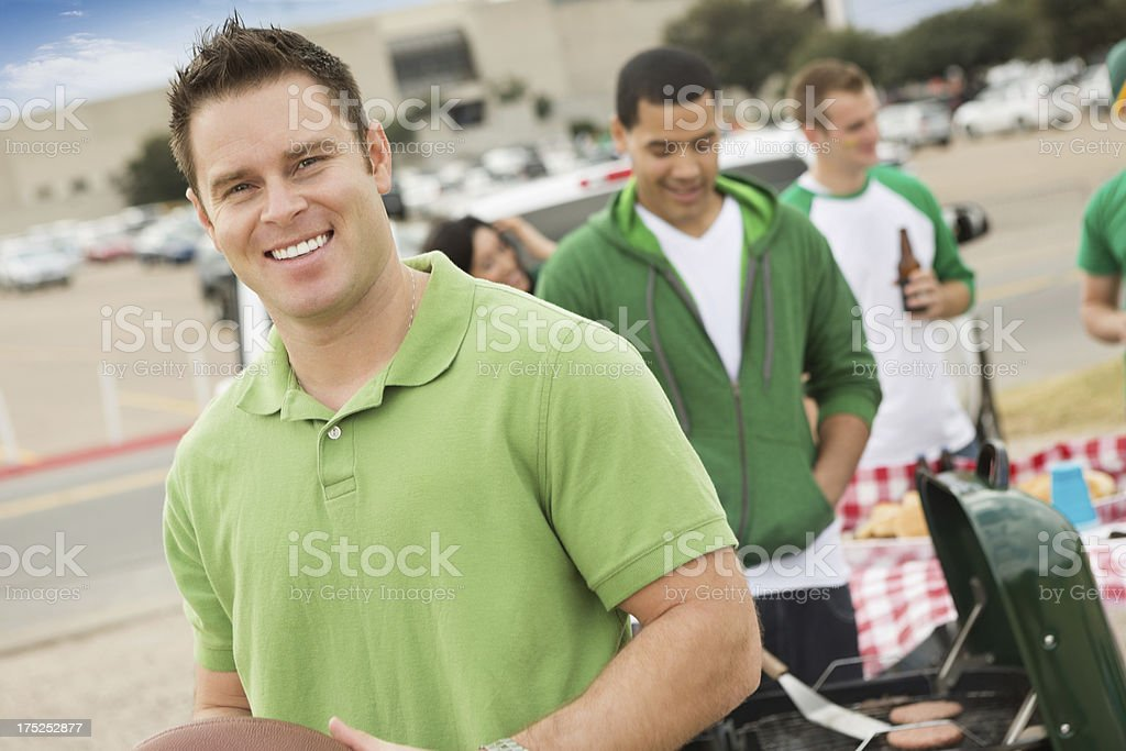 Man tailgating with friends, cooking out near stadium royalty-free stock photo