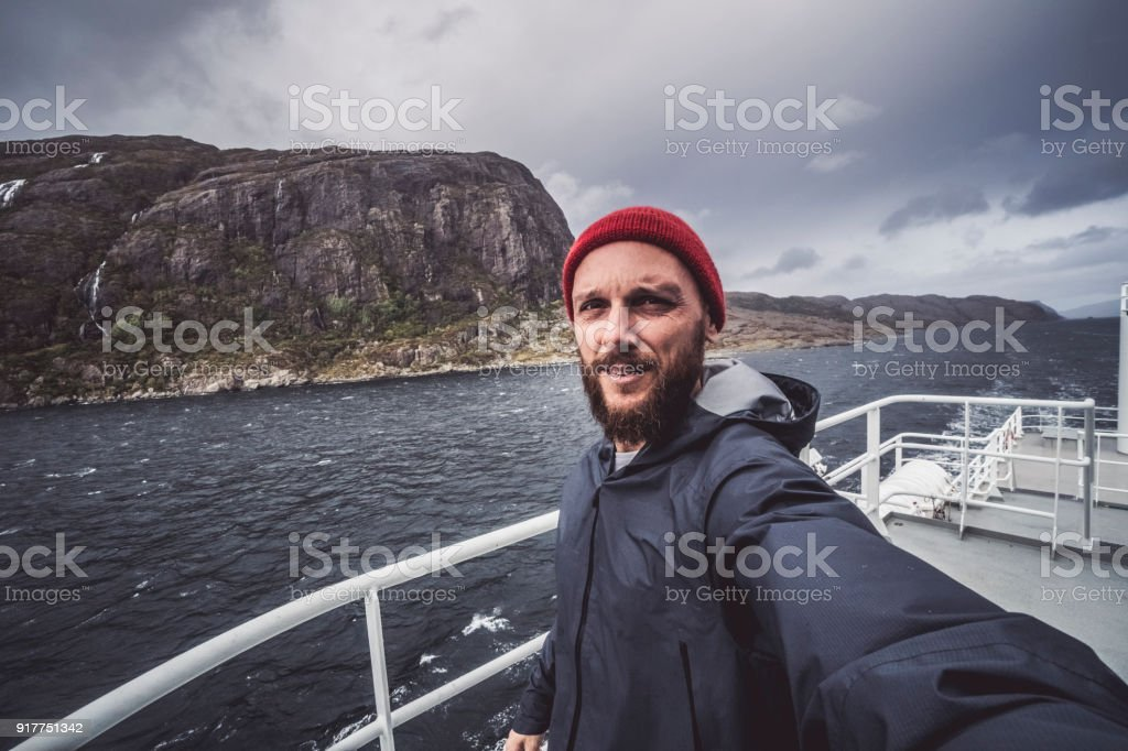 Man take a selfie on sailing vessel stock photo