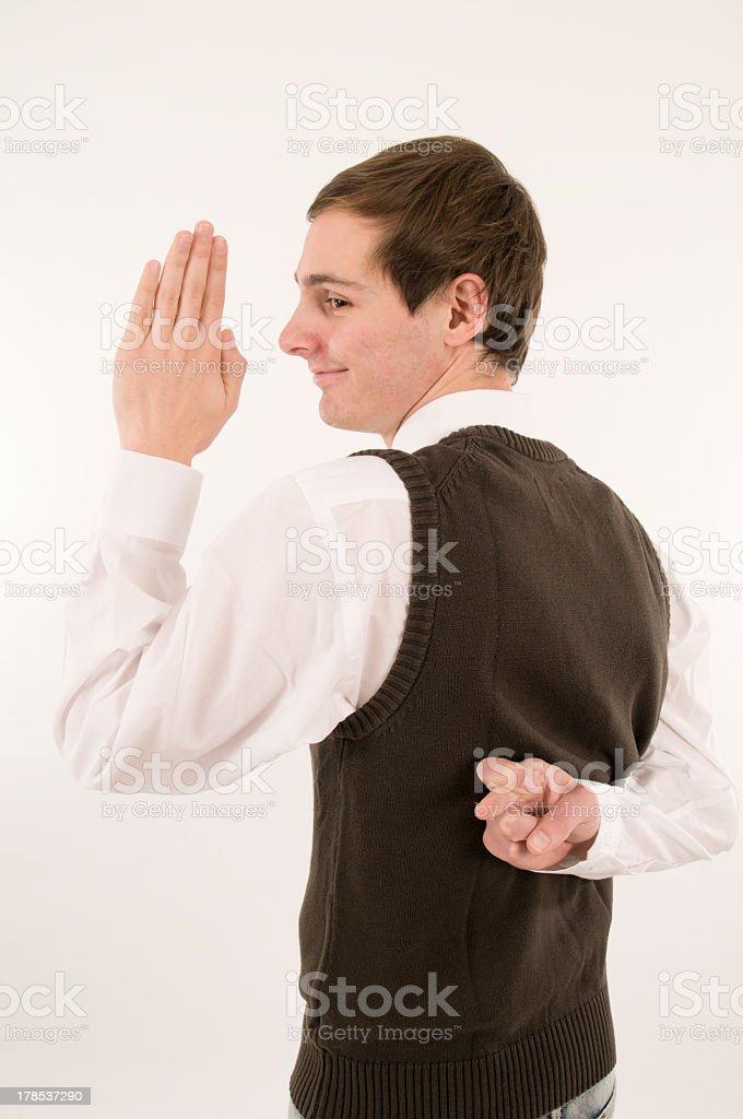 man take an oath cross ones fingers half back royalty-free stock photo