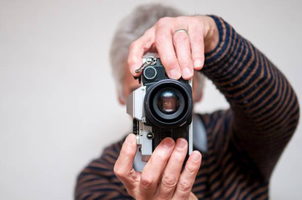 Man takes a photo with a retro camera picture id646132260?b=1&k=6&m=646132260&s=612x612&w=0&h=pq1naxtsfwb85ihn7xhhlizkryj ilnz1kc5avgbhak=