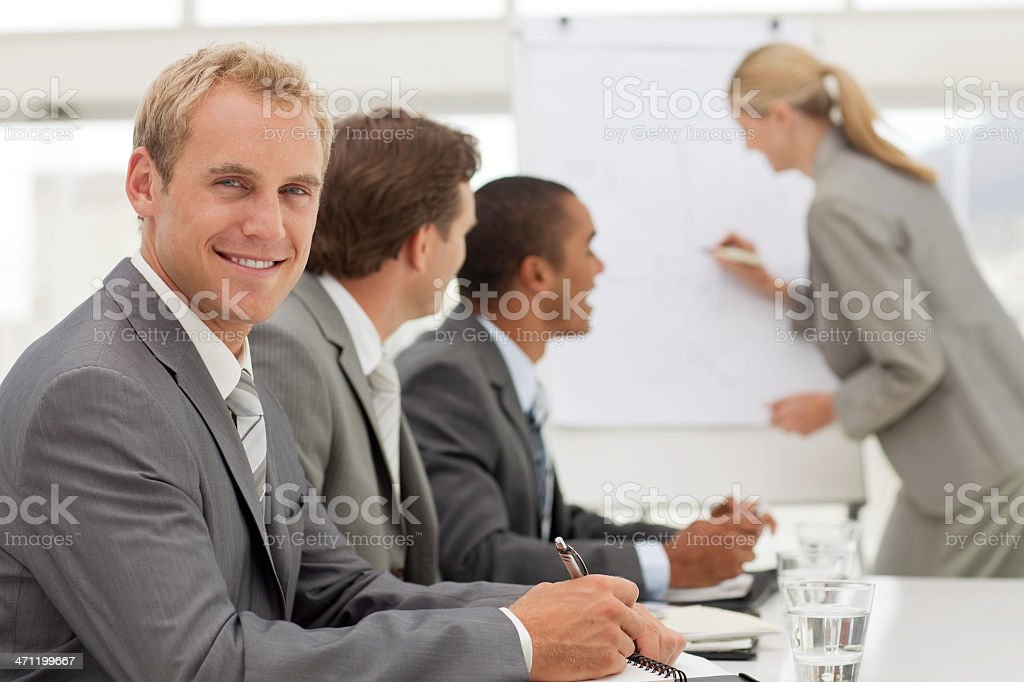 Man takes notes during meeting. royalty-free stock photo