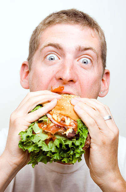 Man takes on burger stock photo