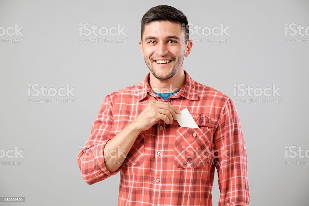 Man takes out blank business card from the pocket royalty-free stock photo