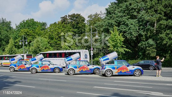 istock Man takes selfie with four BMW Mini Cooper cars with Big Red Bull Cans on top 1152472024