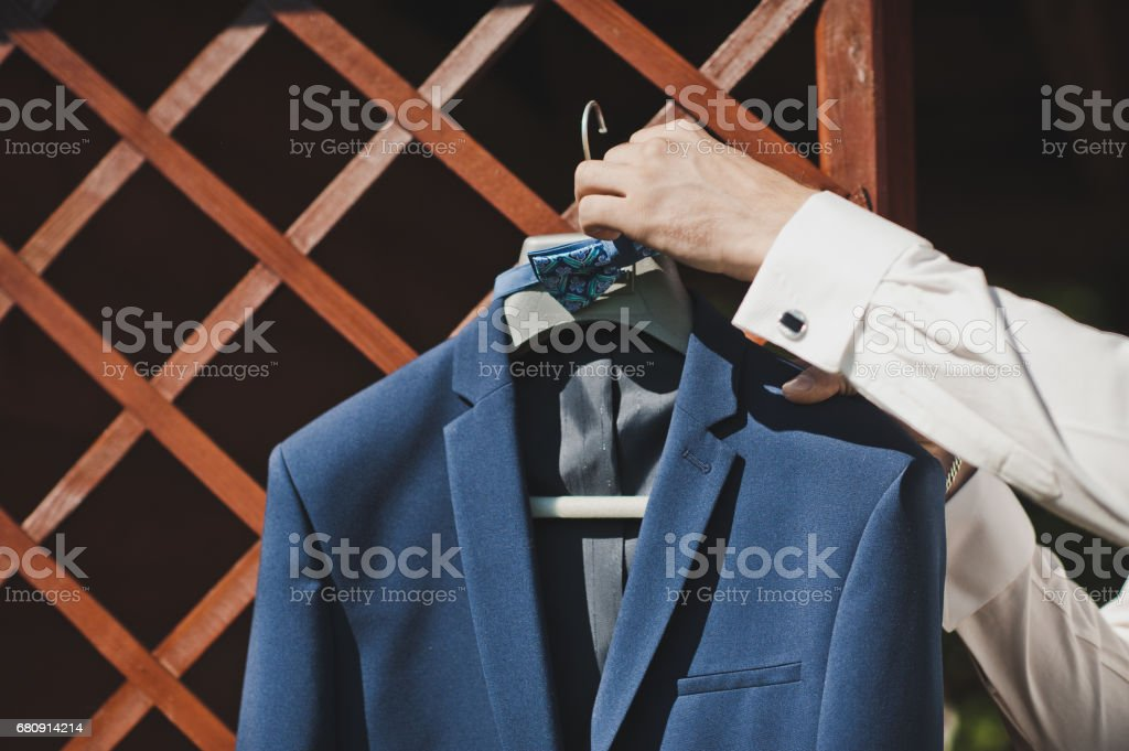 Man takes the suit from the hanger 5036. royalty-free stock photo