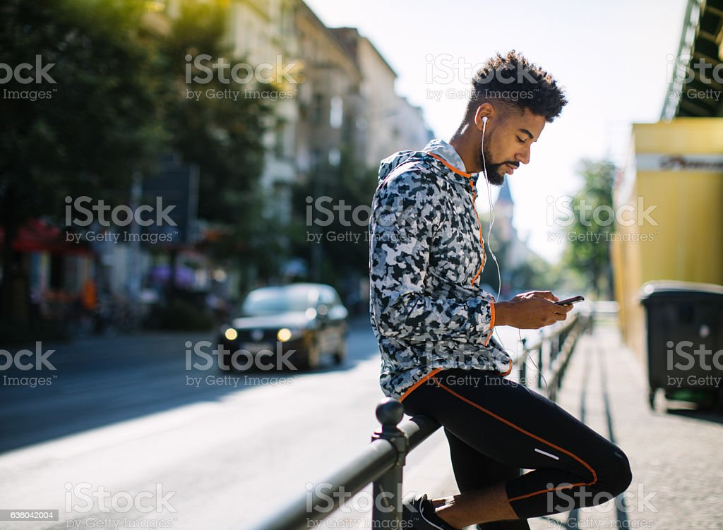 Man taking a break after running session in city stock photo