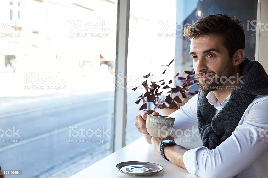 Man taking a coffee break in cafe