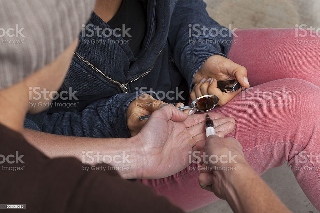 Man taking a dose of heroin stock photo
