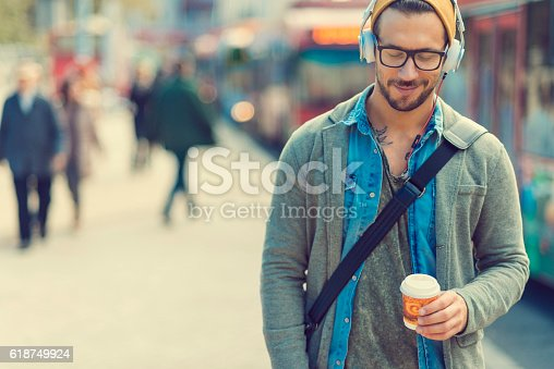 istock man taking a moment and enjoying the music 618749924