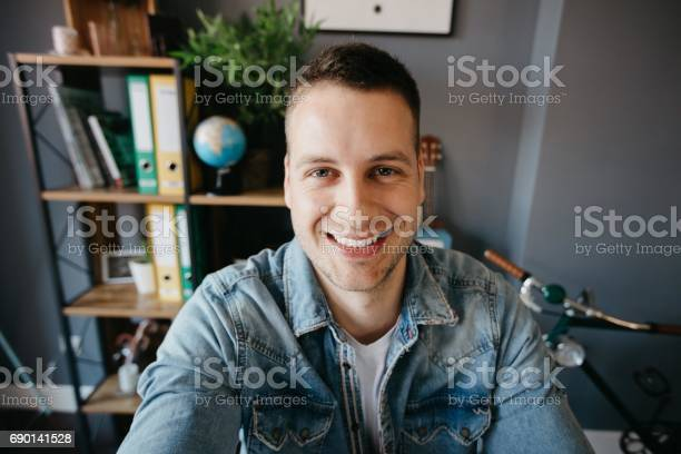 Man taking a photo of himself in the office