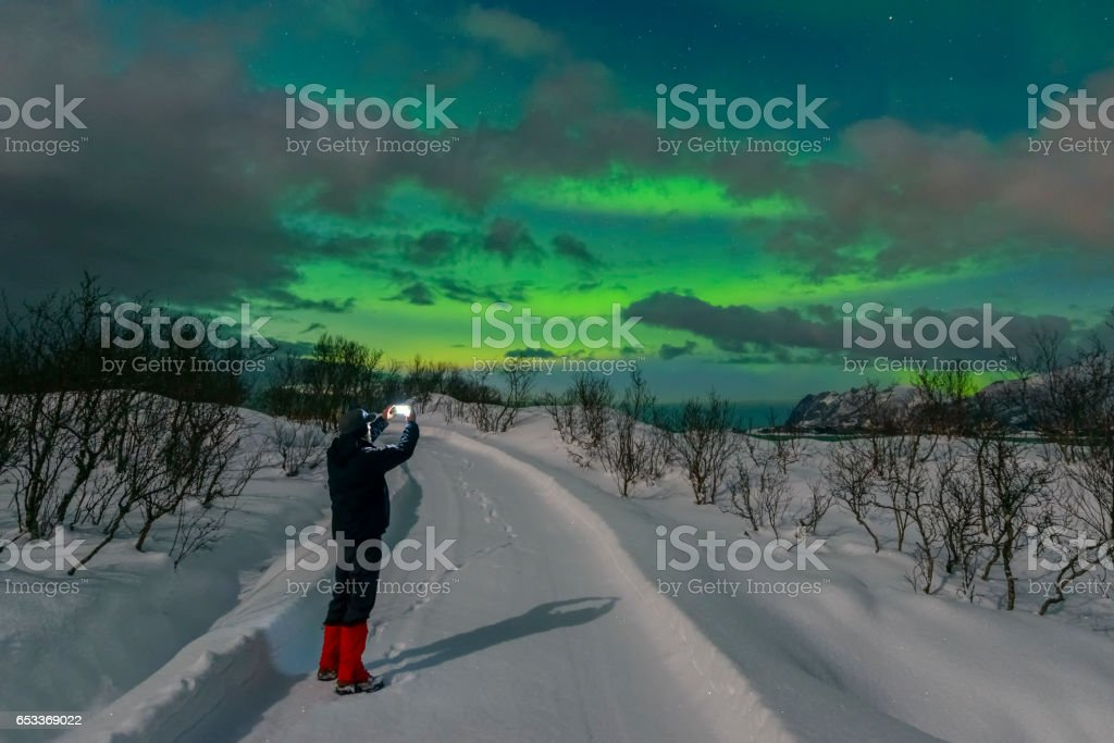 Man taking a picture of the Aurora Northern Polar light stock photo