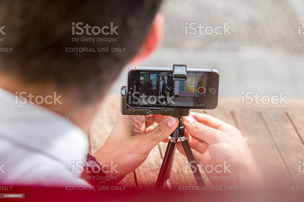 Man taking a picture with his smartphone. stock photo