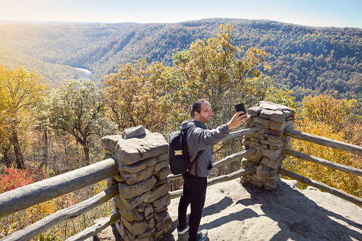 Man Taking A Selfie With Beautiful Fall Scene Stock Photo - Download Image Now