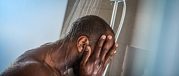 Man Taking a Shower stock photo