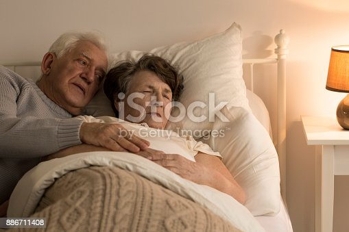 886711404istockphoto Man taking care of wife 886711408