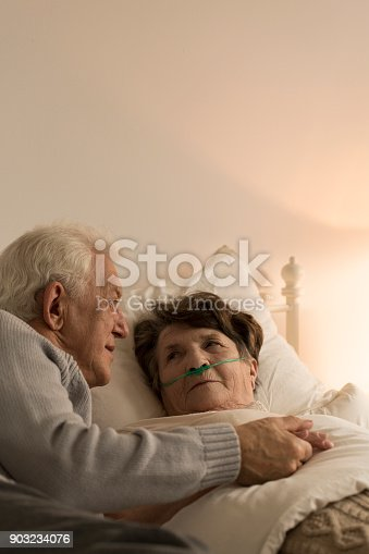829742744istockphoto Man taking care of wife 903234076