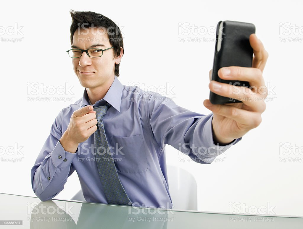 Man taking cell phone picture. royalty-free stock photo