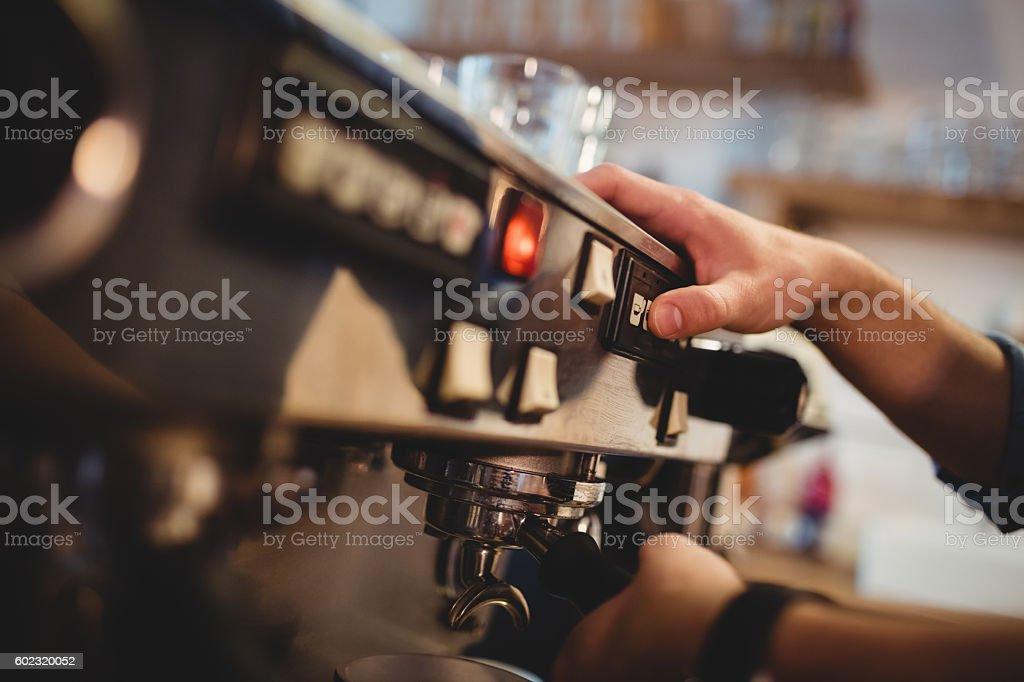 Man taking coffee from espresso machine stock photo