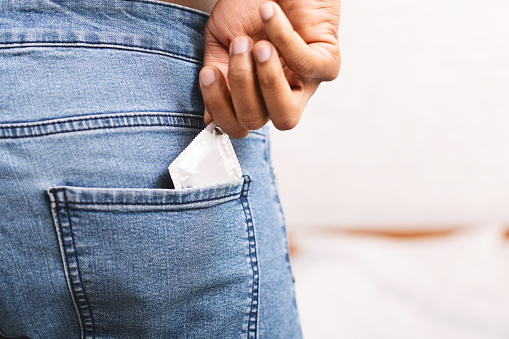 Man Taking Condom From Jeans Back Pocket Stock Photo - Download Image Now