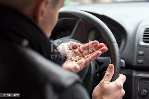 istock Man taking drugs 627312422