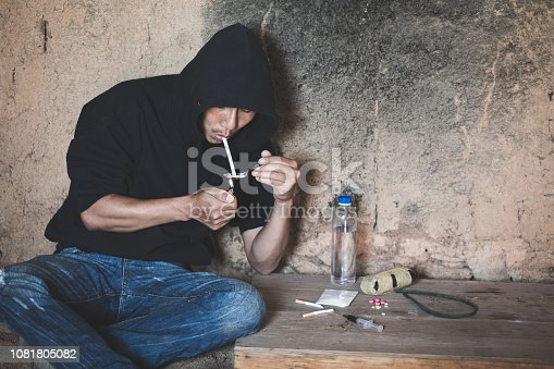 Man taking heroin, cocaine or other narcotic substance,  Drug abuse and addiction concept,  26 June International Day Against Drug abuse.