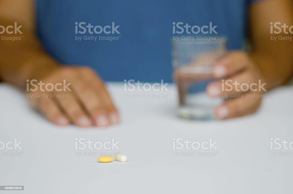 Man taking medication royalty-free stock photo