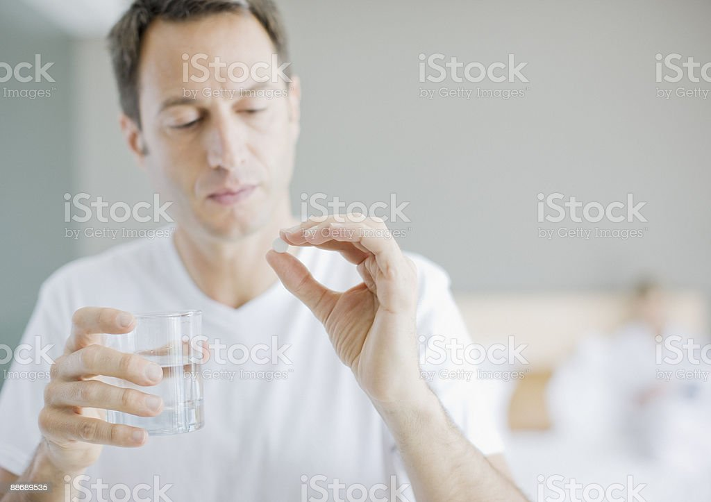Man taking medicine stock photo