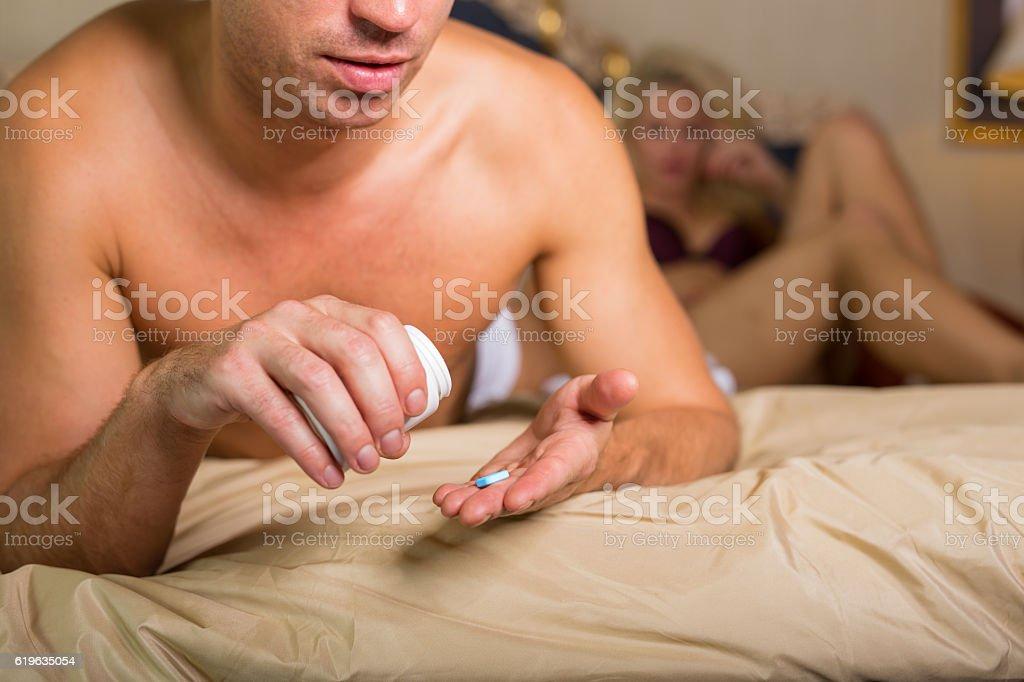 Man taking medicine pill stock photo