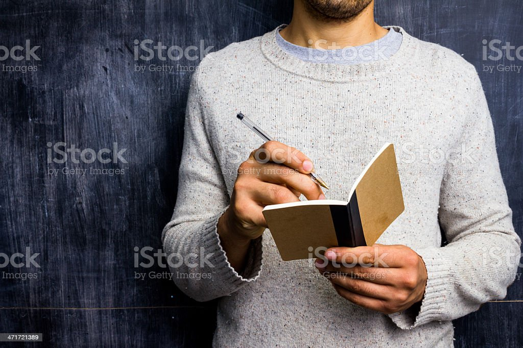 Man taking notes by blackboard royalty-free stock photo