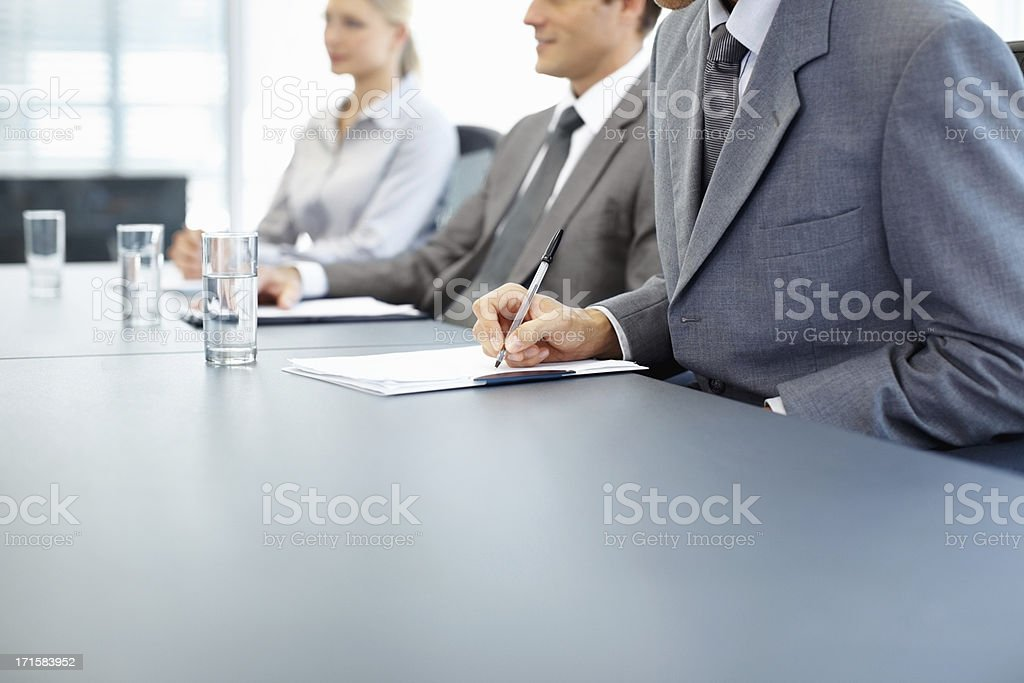 Man taking notes during business presentation royalty-free stock photo