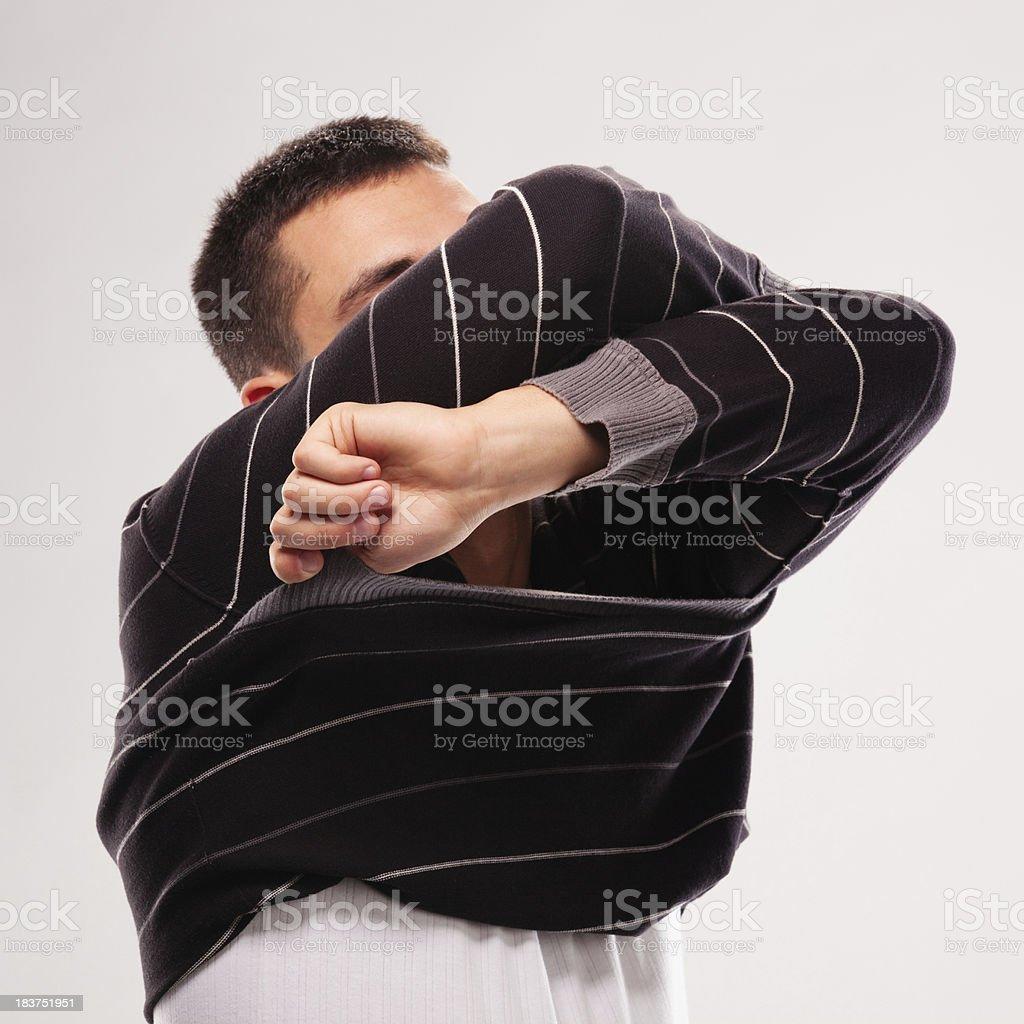 Man Taking Off Sweater royalty-free stock photo