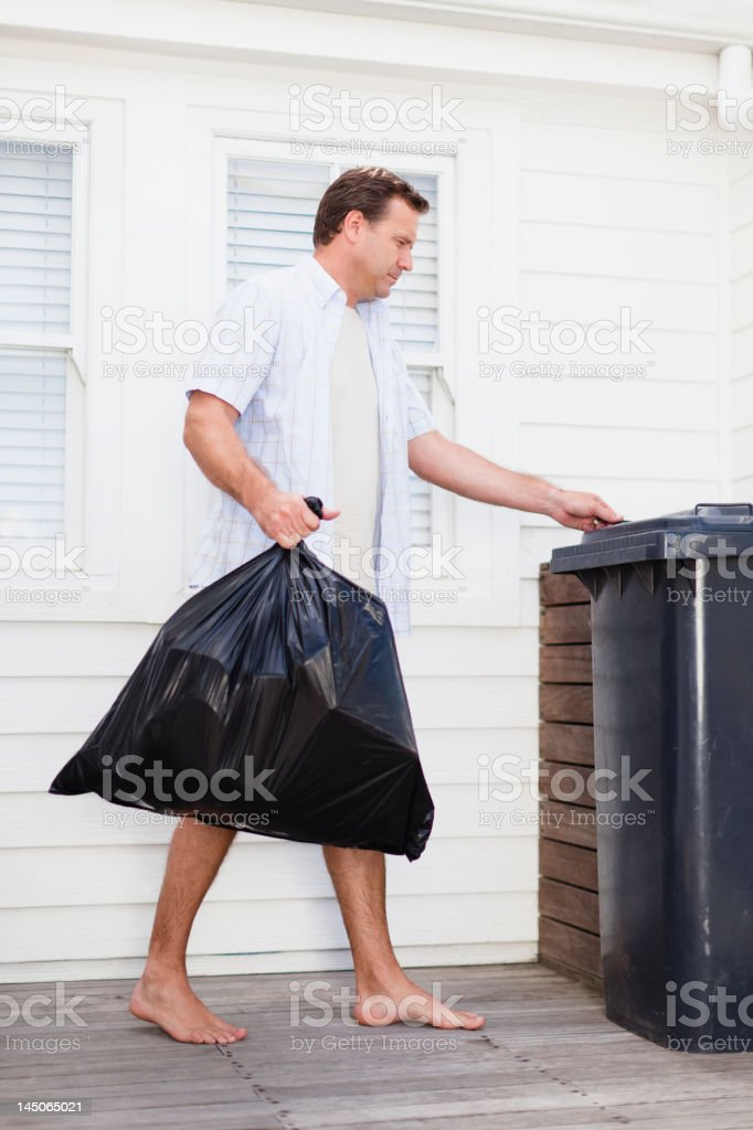 Man taking out garbage stock photo