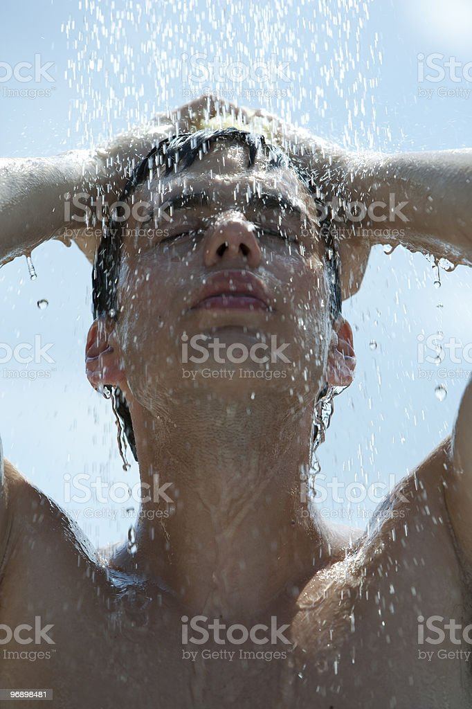 man taking outdoor shower royalty-free stock photo