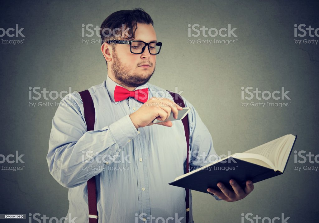Man taking photo of book stock photo