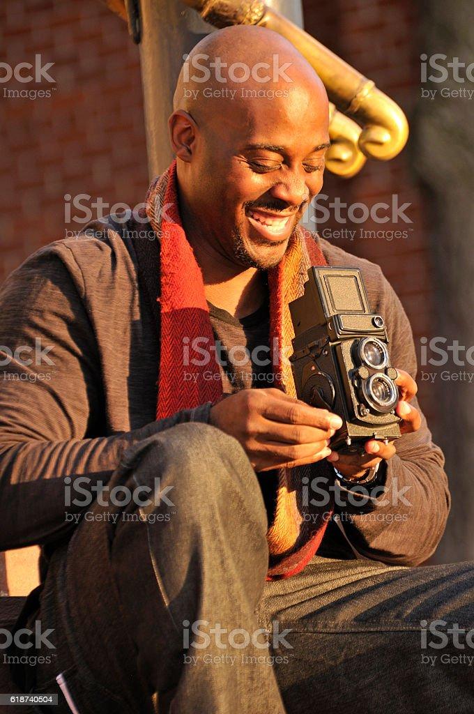 Man Taking Photo with Vintage Camera stock photo