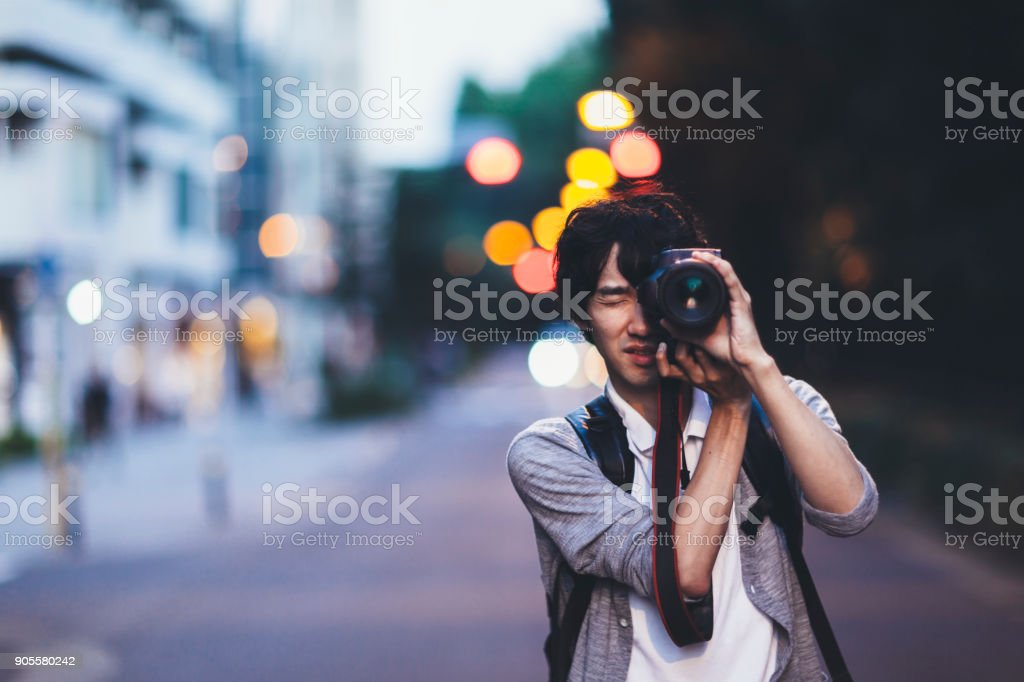 Man Taking Photos At Night stock photo
