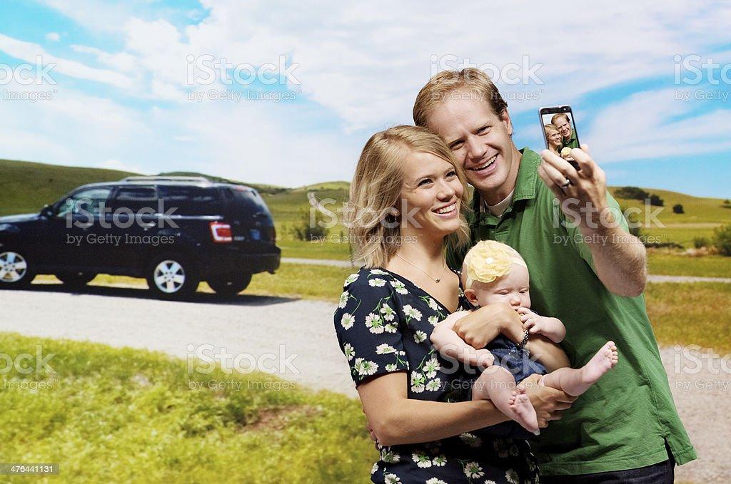 Man taking photos of his family royalty-free stock photo