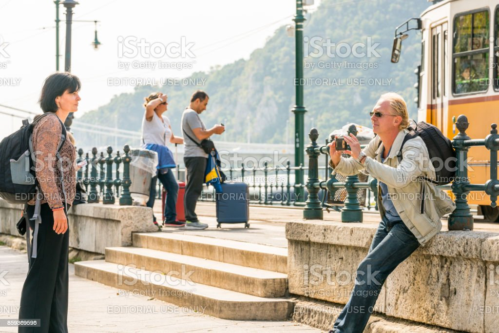 A man taking picture of a woman, two couples on Budapest street. royalty-free stock photo