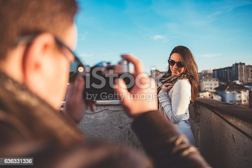 636330566istockphoto Man taking picture with camera 636331336