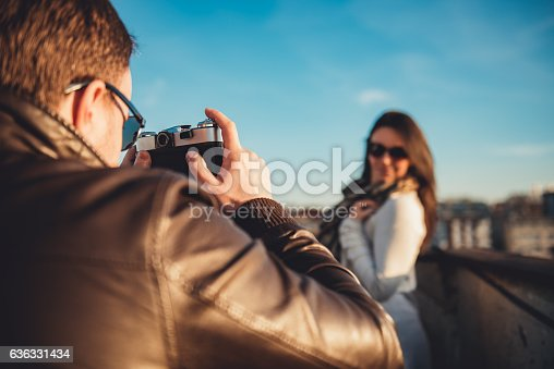 636330566istockphoto Man taking picture with camera 636331434