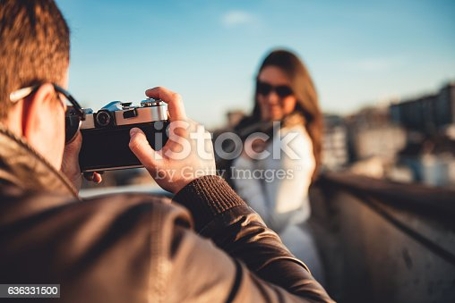 636330566istockphoto Man taking picture with camera 636331500
